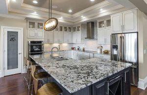 White Kitchen With Blizzard Granite Countertop Granite