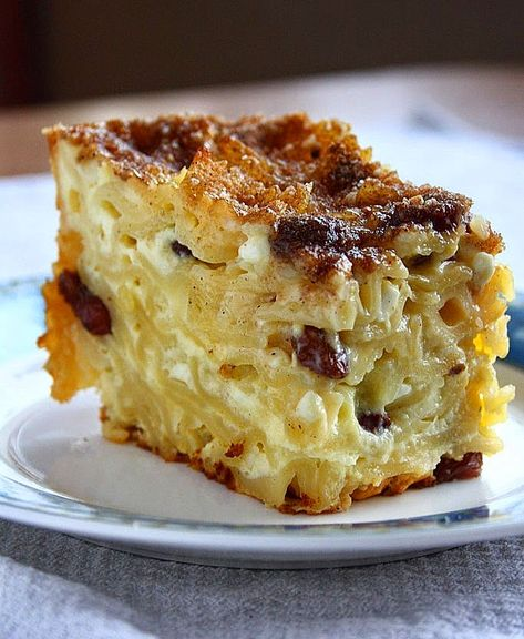 Noodle Kugel: A sweet noodle casserole made with cottage cheese, sour cream and raisins that has a custardy interior and a crunchy sugar