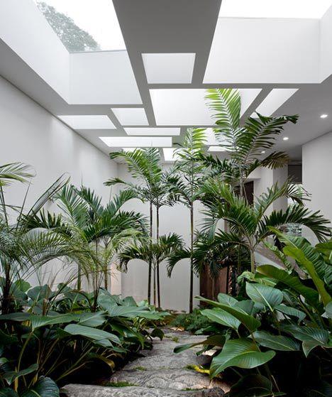 casa grecia by isay weinfeld big leafy foliage plants pinned to garden design by darin bradburyindoor garden separates living room and bedroom - Interior Design Garden