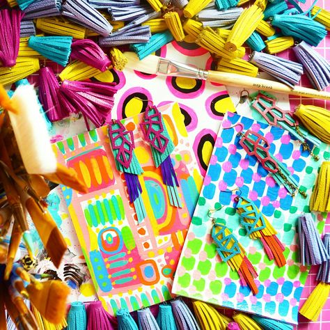 Colorful chaos! Piles of my handmade earrings, hand painted wallets and leather tassels.
