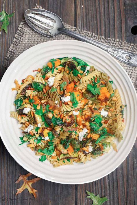 You'll love this versatile fall pasta recipe! Beautiful rotini pasta with butternut squash, brussels sprouts and spinach. A browned butter and olive oil sauce with shallots brings it all together. Works as a side, warm salad, or as a vegetarian main coarse! #pasta #rotini #pastasalad #fallrecipes #fall #butternutsquash #brusselsprouts #brusselssprouts #thanksgiving #holidays #holidaydinner