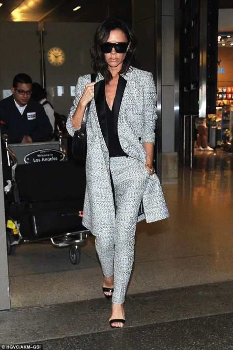 Stylish arrival: Victoria Beckham looked particularly sophisticated when she arrived in Los Angeles on Saturday, following reports that the family has vacated London for the summer
