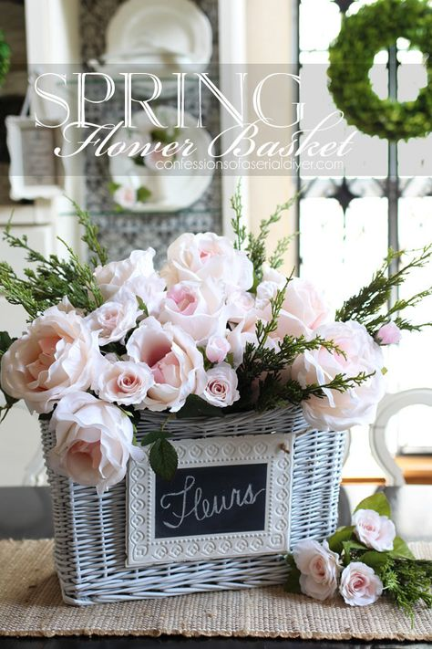 Faux camellias and miniature roses make the perfect Spring centerpiece in this basket. confessionsofaser...