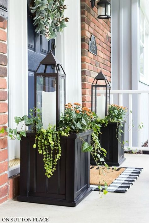 Fall Planter Idea: Lanterns & Mums An easy fall planter id., Fall Planter Idea: Lanterns & Mums An easy fall planter idea using lanterns, copper mums, ivy, and Creeping Jenny. This planter idea is super simple and quick to assemble! Front Door Porch, Planters For Front Porch, Front Patio Ideas, Front Porch Fall Decor, Pergola Ideas, Front Porch Flowers, Summer Front Porches, Porch Plants, Small Front Porches
