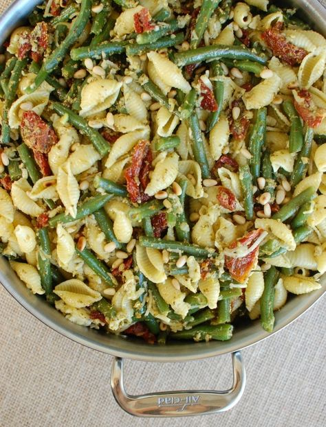 This light, springy meal is vegetarian, packed with flavor and easy to make. Pesto Pasta with Green Beans Sun-dried Tomatoes and Toasted Pine Nuts is sure to be a hit with your family!// acedarspoon.com #pesto #pasta #greenbeans #dinner #pinenuts