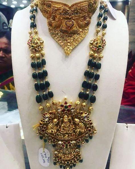 Beautiful emerald haaram with big Lakshmi devi locket. Long haaram studded with precious stones. 12 May 2018
