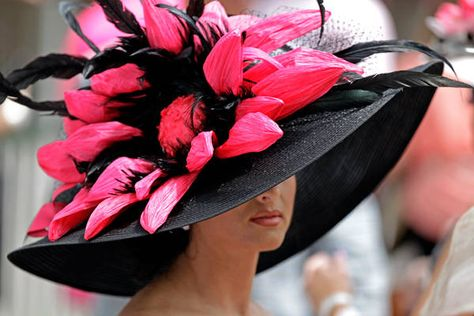 Kentuck Derby 2012  Hats on parade:  When you've got a hat like this, you can't limit yourself to a single day of preening. With more than 100,000 people at Churchill Downs on Friday for the running of the Kentucky Oaks, one day before the Derby, there was plenty of preening fashion plates. Here, Rachel Ford sticks with the floral theme of Derby week.