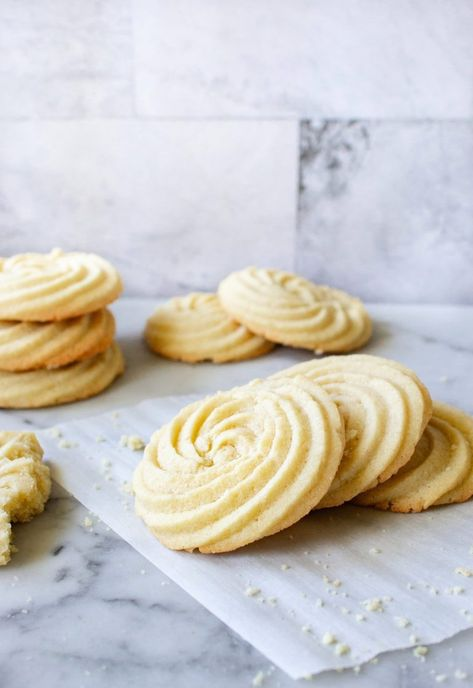 These Soft Butter Cookies are delicate, tender and are melt in your mouth buttery! Also sometimes called Danish Butter Cookies, these cookies have a classic swirl design that is impressive and so easy to make at home! The best, basic butter cookie recipe. #buttercookies #danishbuttercookies #basicbuttercookies #cookierecipes #softcookies