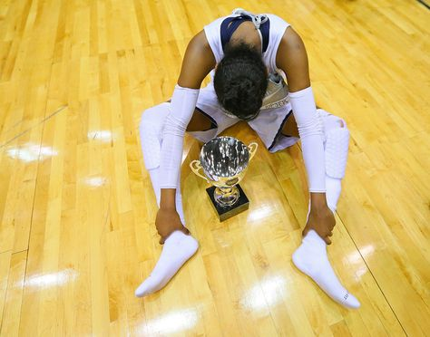 Norcross guard Diamond DeShields sits on the hardwood alone with the championship trophy after defeating North Gwinnett 63-42 in the Class 6A girls high school basketball championship on Saturday, March 9, 2013, in Macon, Ga. DeShields led all scorers with 24 points and lingered after the hoopla was over. (AP Photo/Atlanta Journal-Constitution, Curtis Compton )