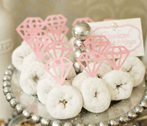 Eliminate ring envy with these powdered donut sparklers. | 30 Swoon-Worthy Engagement Party Ideas #WeddingIdeas