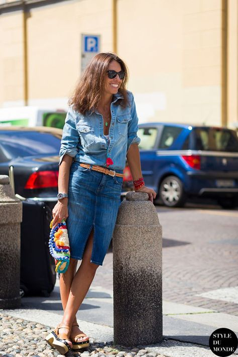 Double denim outfit worn with clogs and a neon tassel necklace.