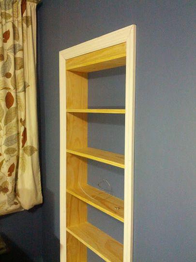 Hidden bookshelf closet like Batman probably had before the Batcave