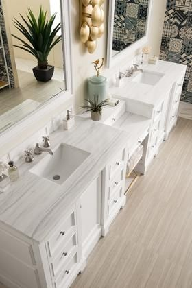 The De Soto 118 Bright White double vanity. 2 cabinets connected by a matching make-up counter.Premium features include a plinth base. one electrical component with usb ports. and one faux shagreen drawer organizer. Ample interior drawer and shelf sp...