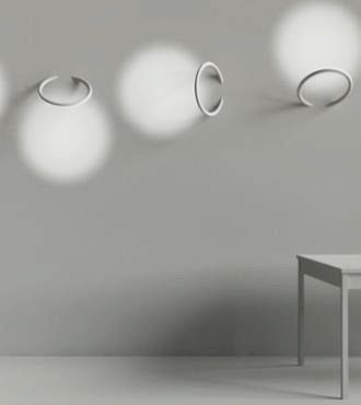 Wall-piercing LED lights by Flos enable creative, even playful, designs. Linked, the lights create a wall sculpture when unlit and a complex play of shadow and light when lit.