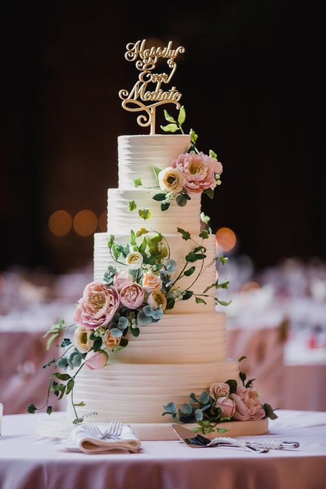 Five-tier buttercream cake with romantic sugar flowers. Photo by Silver Thumb Photography.