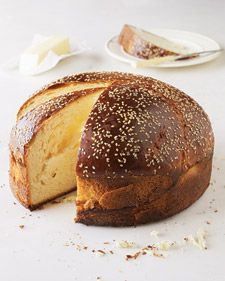 """In Greece, the Christmas fast is broken on Christmas Eve with Christopsomo, or the """"bread of Christ."""" This round loaf draws its distinctive licorice-like flavor from mastic gum, the dried resin of a Mediterranean tree. After the dough rises, it is coiled into a snail shape; then the dough, sprinkled with sesame seeds, puffs into a dome when baked. Martha Stewart Living senior food editor Christine Albano based this recipe on her grandmother's. Some families decorate the bread with strips of d..."""