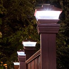 Set of 4 brown mini round solar fence lights lamplust httpwww we need deck railing and these post top lights would be perfect for providing that light ambiance were looking for mozeypictures