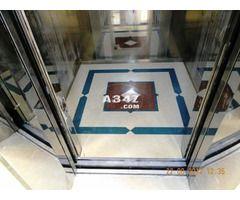يظهر منظر حجر المارون الرائع بشكل لافت في واجهات الكابين والاطار المصنوع من الاستانليس الاستيل الذهب Stair Lift Elevation Installation