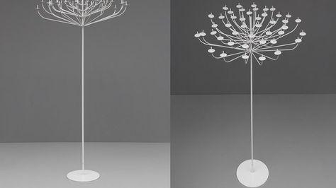 Le chandelier 129, édité par Pierre Disderot en 1959, est un objet atypique, inspiré de la nature et qui fait penser à une sculpture. La multiplicité des branches allumées par les fines bougies, enrichit l'ambiance générale lumineuse de la pièce. Eteint, la magie de l'objet ne faiblit pas et se rapproche du travail des américains Curtis Jere ou Harry Bertoia, entre art et le design. En métal laqué.