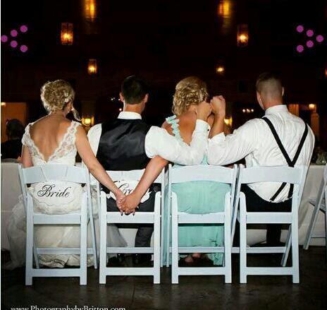 This moment between the bride, groom, bridesmaid, and the best man is just too cute.