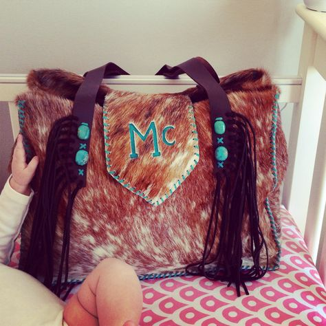 The Buckaroo Diaper Tote with custom turquoise suede brand, turquoise stones and suede fringe. gowestdesigns.us