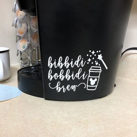 "Listing for one decal with quote ""bibbidi bobbidi brew"" with coffee cup and wand This can be applied to any flat smooth surface. Shown on a keurig but can be applied to other coffee makers You choose color Disney Kitchen Decor, Disney Home Decor, Disney Diy, Disney Crafts, Disney Magic, Disney Stuff, Cricut Craft Room, Cricut Creations, Keurig"