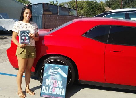 """📚 The only Muthaf'ka that's COLD in this Triple Digit Heat! 🌞 Fly Anna Kim of #southkorea coolin w/the International Best Seller 📚 MORAL DiLEMMA by Legendary Ali Shabazz. """"This book deserves a Rick James Degree, its Cold Blooded!"""" #moraldilemma #goodreadschallenge #followme #bookstagram #books #readers #nook #kobo #invest #WestLosScandelous #younglocspart2 #literature #library #CuttyMackPublishing #SnowFallFx #quentintarantino"""