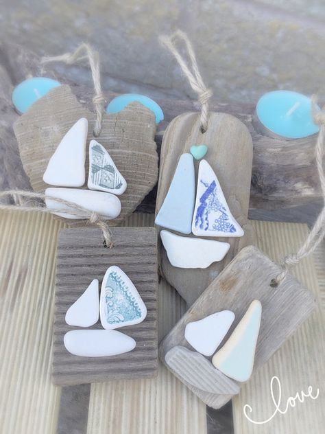 A beautiful hand selected piece of Isle of Wight driftwood adorned with beautiful sea pottery to create a sailboat go into making these unique nautical hangings. Approximate size of wood is 4 and you will receive one beautiful random hanging. Can do large orders of these so please message me and I can give you a better price on a larger amount Please message me if you have any questions and I will get back to you and please take a look at my other items  Please also take a look at my Facebook...