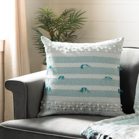 Warm and welcoming, the Billi Throw Pillow brings a cheerful coastal-cool vibe to room decor.