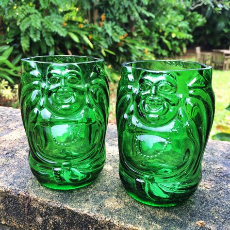 Awesome and Beautiful green glasses cut from Lucky Buddha beer bottles. These glasses are shaped like little Buddhas and durable for everyday
