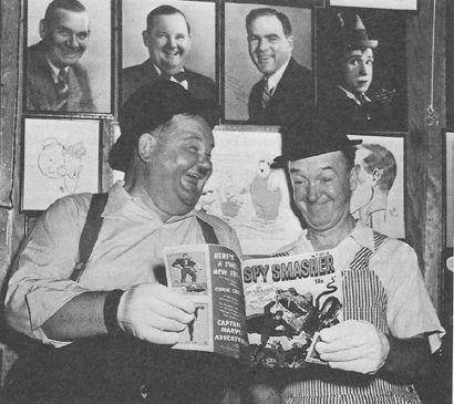 Stan Laurel and Oliver Hardy reading a Spy Smasher comic
