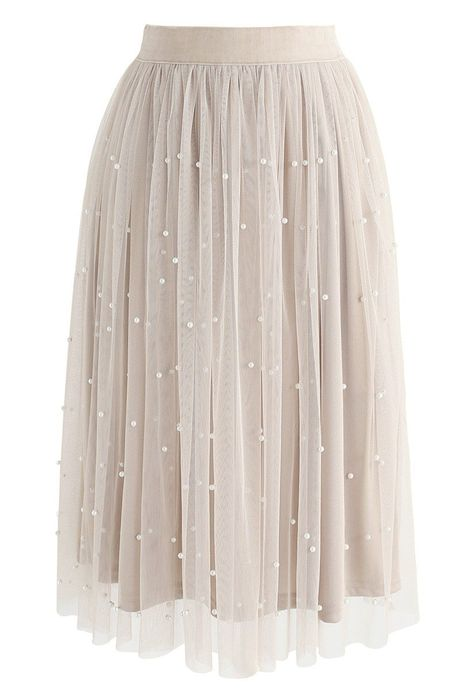 Ballerina vibes! Step out with the grace of a dancer when you slip into this creamy mesh skirt with pearl embellishments.  - Mesh fabric finished  - Pearls embellished  - Elastic waistband  - Lined - 100% Polyester - Hand wash cold