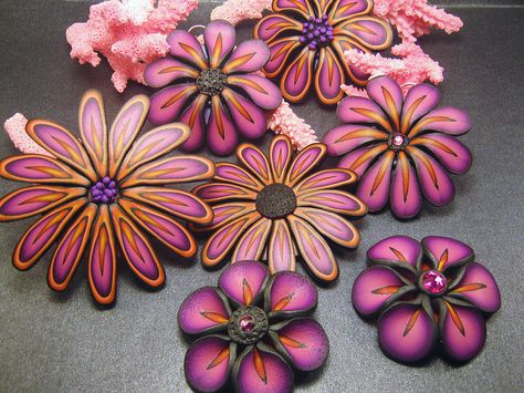 Beautiful color coordinated polymer clay flowers. Flower Frenzy by DebbieCrothers, via Flickr
