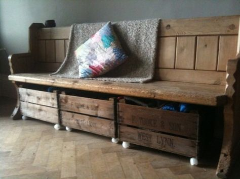 Antique pew with crates underneath. Cute idea. Back room or conservatory.