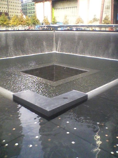 Twin Towers Memorial (photo credit ~ Dianne McLaughlin)  The Memorial's twin reflecting pools are each nearly an acre in size and feature the largest manmade waterfalls in the North America. Both pools sit within the footprints where the Twin Towers once stood. Architect Michael Arad and landscape architect Peter Walker created the Memorial design.