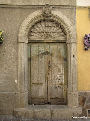 Italian door with a story to tell: Years ago, when one of the owners of a home passed away, his or her death was recorded with a black line painted across the door. When the spouse also passed away, another line was painted. That the two lines are touching on this door means that the passing of the owners occurred at the same time.  Credit: http://bit.ly/xU3SUD