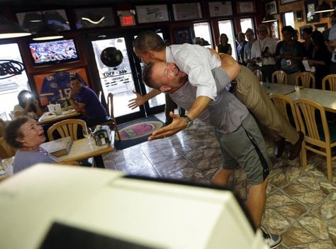 BEST. HUG. PHOTO. EVER. President Barack Obama holds on as he is hugged and picked up by Scott Van Duzer at Big Apple Pizza and Pasta Italian Restaurant (Pablo Martinez Monsivais/AP)