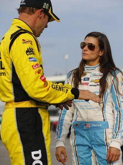 Matt Kenseth and Danica Patrick speak prior to qualifying for the Federated Auto…