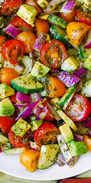 mediterranean recipes Spring Salad with Tomatoes, Cucumber, Avocado, and Basil Pesto. This healthy, Mediterranean recipe features lots of fresh vegetables. This recipe uses ju Avocado Recipes, Healthy Salad Recipes, Veggie Recipes, Diet Recipes, Cooking Recipes, Fresh Basil Recipes, Summer Vegetarian Recipes, Cherry Tomato Recipes, Recipies