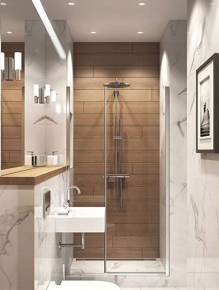 Faux Wood Ceramic Tiles Add Warmth To An Otherwise Sterile Shower Modern Small Bathrooms Small Bathroom Small Bathroom Remodel