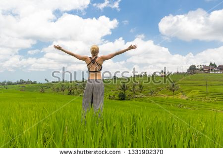 Stock Photo Relaxed Woman Arms Rised Enjoying Life Of Beautiful Green Rice Fields On Bali Young Lady Feeling Free Relaxed An Enjoy Life Photo Stock Photos