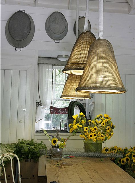 burlap lights. Love the pans hung on the wall!