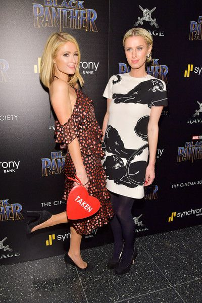 Paris Hilton (L) and Nicky Hilton Rothschild attend the screening of Marvel Studios' 'Black Panther' hosted by The Cinema Society.