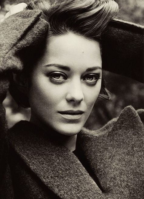 Marion Cotillard  dunno what movie I saw her in but she has the most interesting face...duh, the newest batman its tahlia