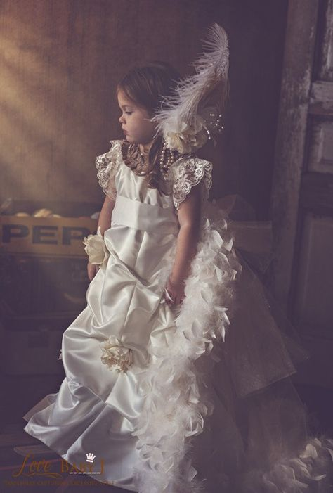A Gorgeous Custom made Flower Girl Dress Irresistible in shades of Champagne and ivory, Love Evangeline is sure to leave you speechless! This stunning dress features ivory satin fa