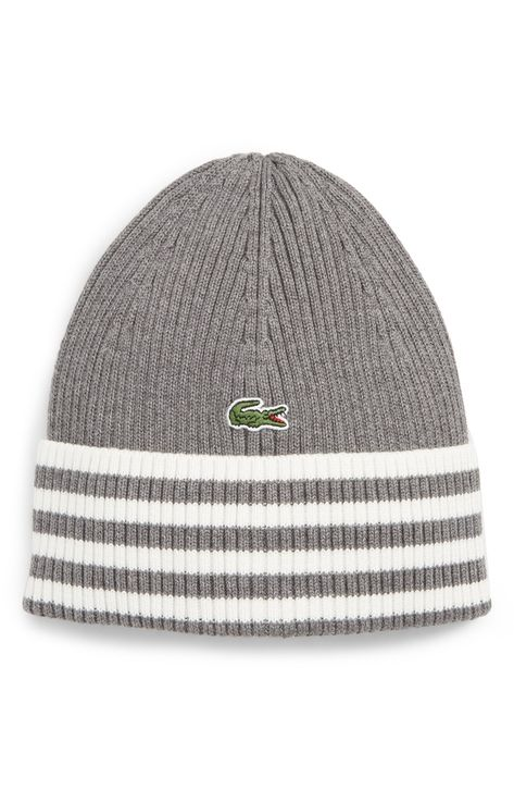 7182fc16e2c Free shipping and returns on Lacoste Striped Beanie at Nordstrom.com. A  striped cuff brings smart