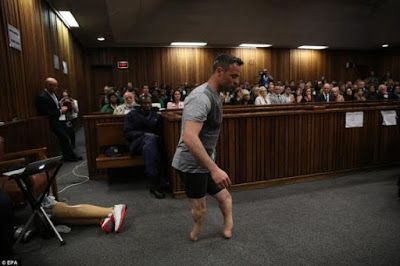 Oscar Pistorius breaks down in tears and walks without prosthetic limbs in courtroom as he pleads for lighter sentence