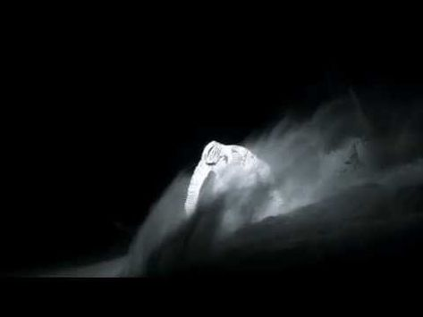 Snowboarder wearing solid LED suit looks like a ghost gliding through the night.         There is a whole lot of technology is this piece. From the suit to the camera used.