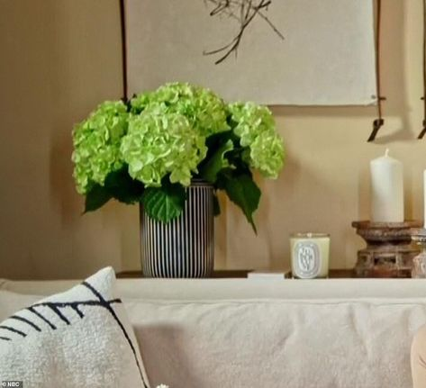 1. Vase of green hydrangeas: On the left hand side of the frame is a bouquet of large white flowers, placed in a huge statement vase. The Duchess has long favored mid-century modern furniture and a white color palette, and added vibrant pops of color with accessories such as a huge bouquet of flowers. Meghan has always been a fan of fresh flowers, with pink peonies declared as her favorite.