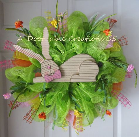 EASTER..SPRING Deco Mesh Wreath. Love the flowers springing out for the sides!